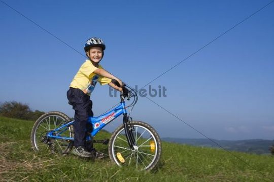 Boy, 6 years, on a bike