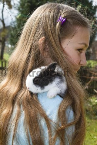 Girl, 10 years old, with a pet rabbit, Bavaria, Germany, Europe