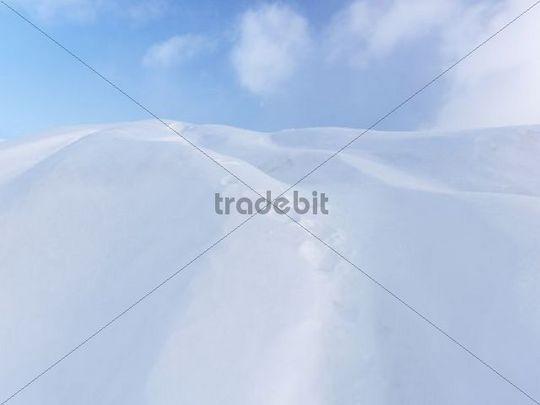 Snow dunes under blue sky, Ontario, Canada