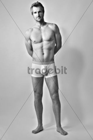 Man wearing underpants, black and white photograph