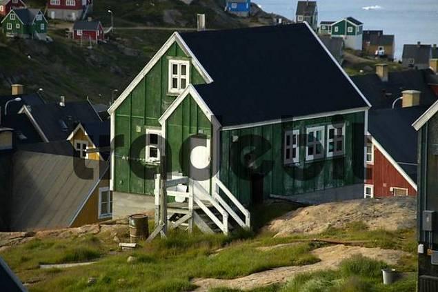 Old green wooden house settlement Ammassalik Eastgreenland