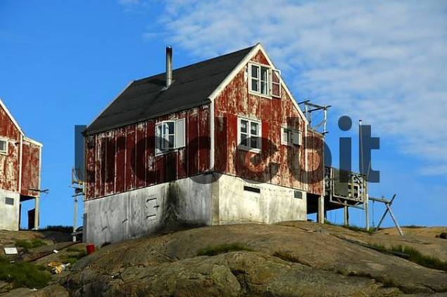 Old red wooden house on rock Ammassalik Eastgreenland