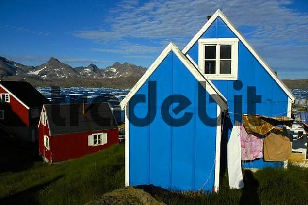 Blue and red wooden house in settlement Ammassalik Eastgreenland