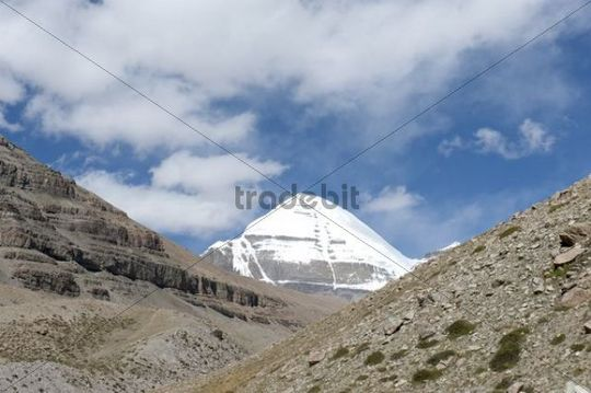 Tibetan Buddhism, snow-covered holy Mount Kailash, Gang Rinpoche mountain, south face with cleft, pilgrims´ path near Selung Gompa monastery, Kora pilgrimage, Ngari Prefecture, Gangdise Mountains,