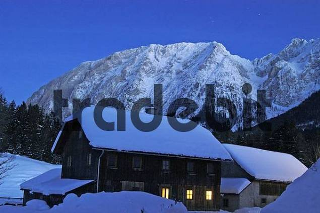 a farmhiuse and the mountain Grimming viewed from the small village Krungl near the cross country skiing center of Bad Mitterndorf Styria Austria