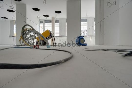 Construction site, interior, drying equipment with electricity cables, drying out the rooms