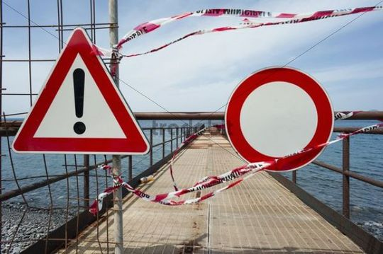 Warning sign and no access sign on an old loading pier, Isola Eole, Sicily, Italy, Europe