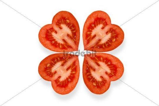 Heart-shaped tomatoes arranged like a cloverleaf