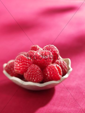 Raspberries in a small bowl