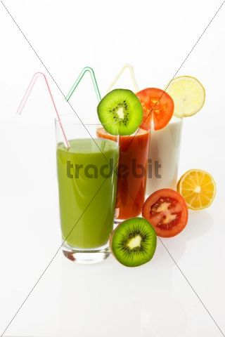 Kiwi and lemon yogurt drinks and tomato juice in glasses with fruit
