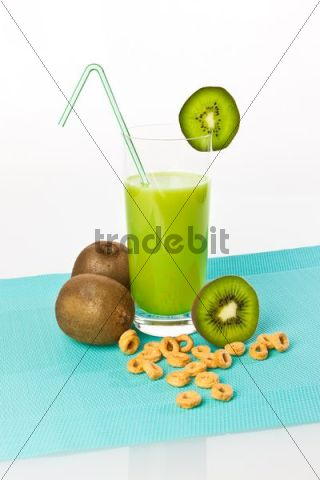 Kiwi fruit drinking yoghurt, kiwi shake in a glass with kiwi fruit and cereals