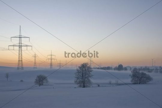 Winter landscape with power poles at Remptendorf, Thuringia, Germany, Europe