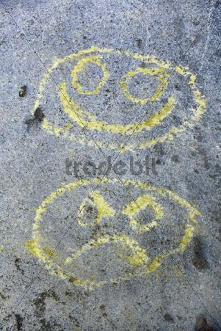 Drawing on rock, faces, laughter and anger