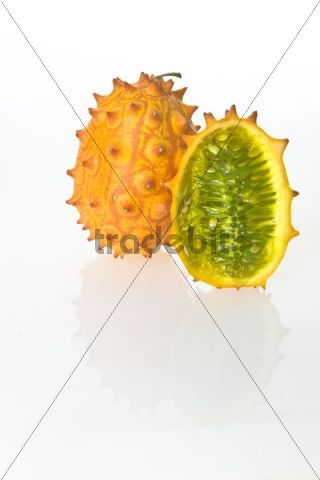 Two Kiwanos, Horned Melons or African Horned Cucumbers (Cucumis metuliferus), one cut in half