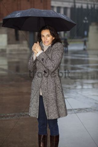 Woman holding an umbrella in the rain