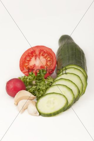 Cucumber with tomatoes, radishes, parsley and garlic cloves