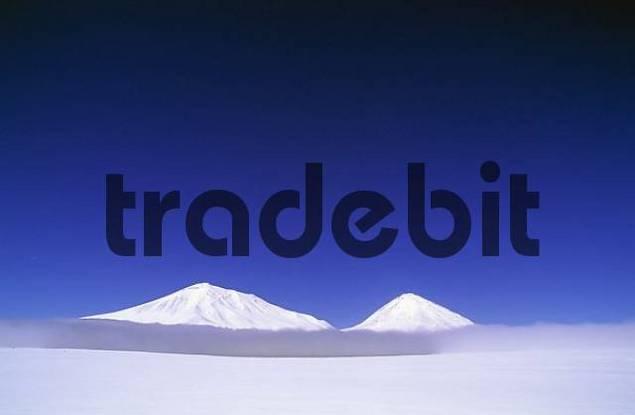 Volcano Licancabur above clouds over Laguna Verde, Potosi, Bolivia