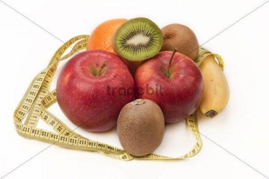 Fruit with measuring tape, orange, apples, kiwi, banana