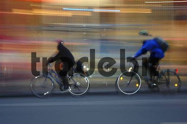 two people driving bicycle