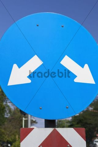 Road traffic sign showing left and right turning ahead only