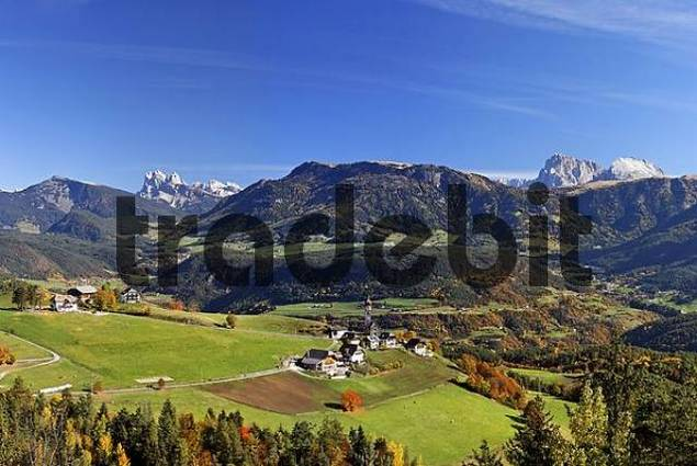 the village of Mittelberg and at the left the mountain Sass Rigais 3025m and at the right the Langkofel and the Plattkofel, Rittener mountain, South Tyrol, Italy