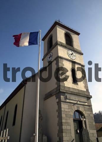 Church and Frech flag in Goldbachm Alsace, Vosges, France