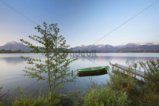 Jetty and boat on Lake Hopfensee in the evening, Allgaeu, Bavaria, Germany, Europe