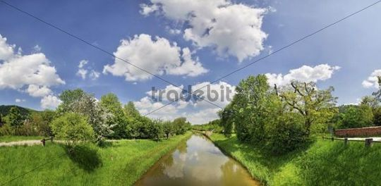 Clouds over the old Ludwig Canal or Ludwig-Donau-Main-Kanal with flowering fruit trees, Naturpark Altmuehltal nature forest, Bavaria, Germany, Europe
