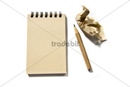 Notepad with a pencil and a piece of crumpled paper