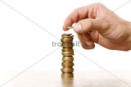 Stack of coins, symbolic image for savings, money growth