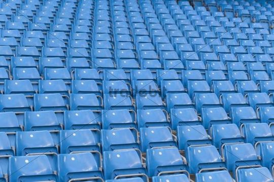 Rows of blue seats at the Manchester City football stadium in Manchester, England, United Kingdom, Europe