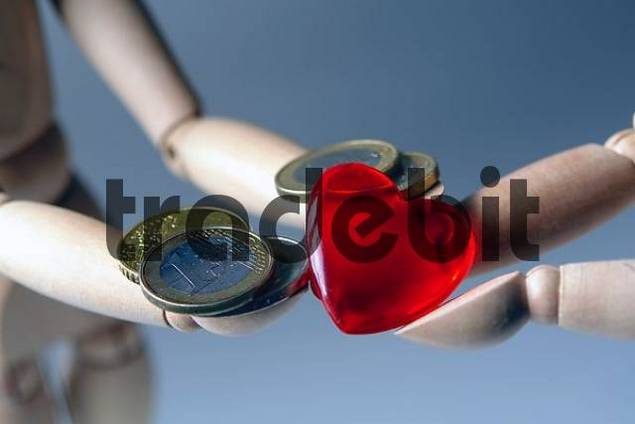 two wooden figures giving each other a red heart and a Euro coin