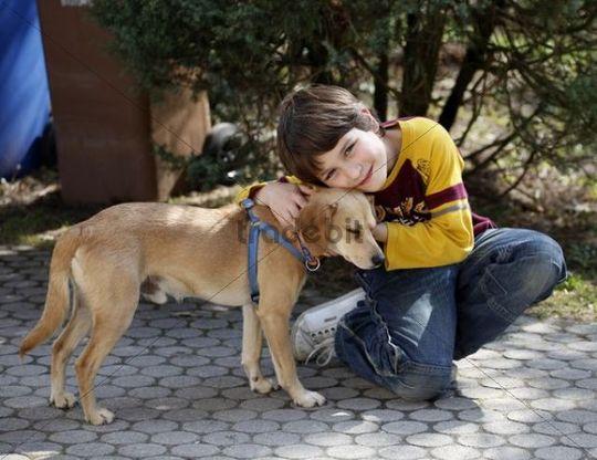 Boy, 9, with a dog