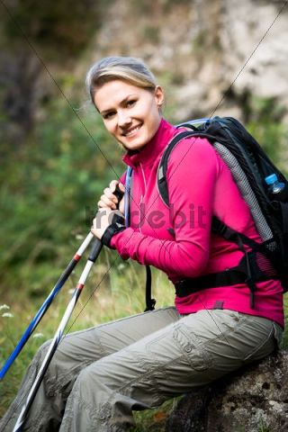 Young woman hiking in Dolomite Alps, Dolomites, Italy, Europe