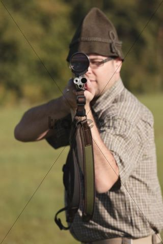 Hunter with a rifle at the ready