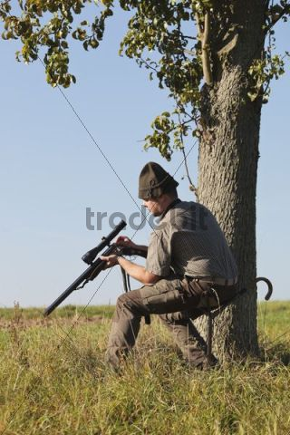 Hunter on a driven hunt, reloading his rifle