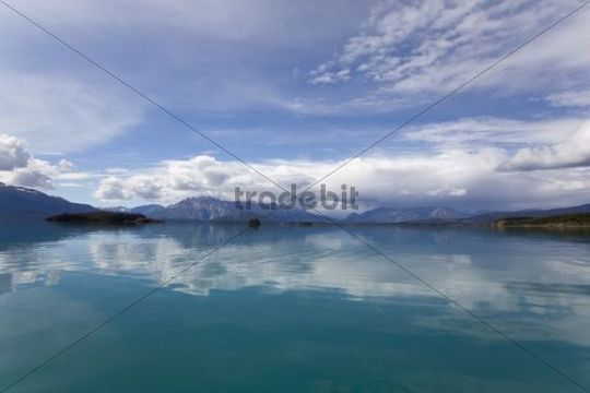 Cloud reflections on calm Atlin Lake, mountains behind, Tagish Highland, British Columbia, Canada, America