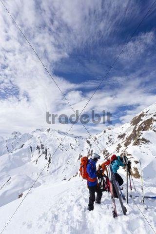 Touring skiers on Staudenberg Joechl ridge, Ridnaun, above Schneeberg, Sterzing, province of Bolzano-Bozen, Italy, Europe