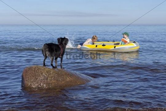 Mother and son in a rubber boat, dog watching, Kuehlungsborn-West, Mecklenburg-Western Pomerania, Germany, Europe