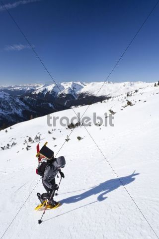 Snowshoe walker during the ascent to Mt Pfattenspitz above Durnholz, Sarn Valley, South Tyrol, Italy, Europe