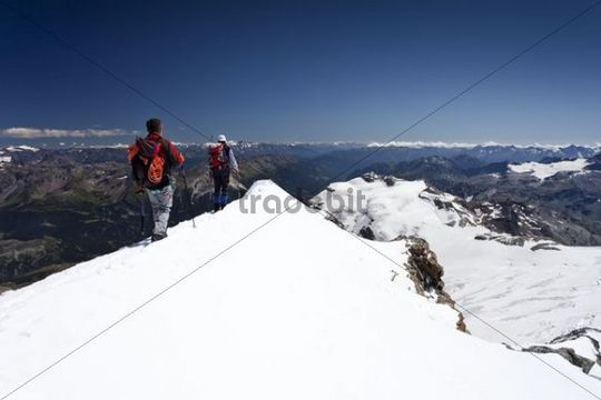 Mountaineer on the summit ridge, descent from Mt Piz Palue, Grisons, Switzerland, Europe