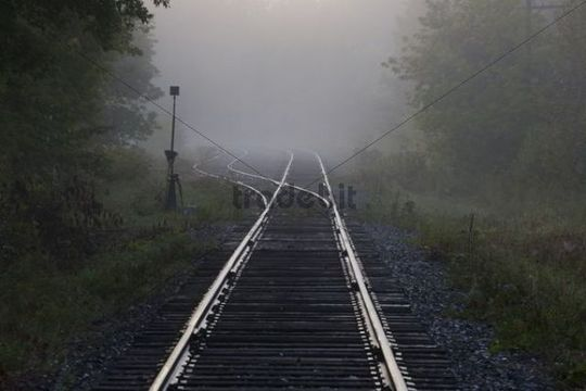 Railway tracks in early morning mist, Foster, Quebec, Canada