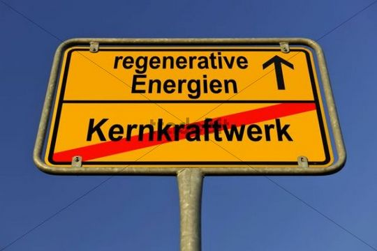 City limits sign with the words regenerative Energien and Kernkraftwerk, German for renewable energy and nuclear power station, symbolic image for the end of nuclear power through the use of renew