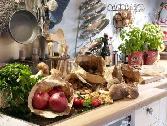 Kitchen still life with pomegranates, mushrooms, tomatoes and basil