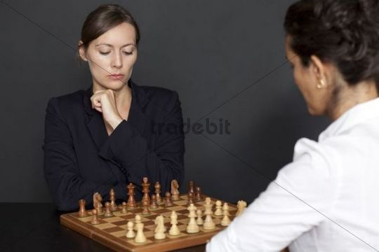 Two women playing chess
