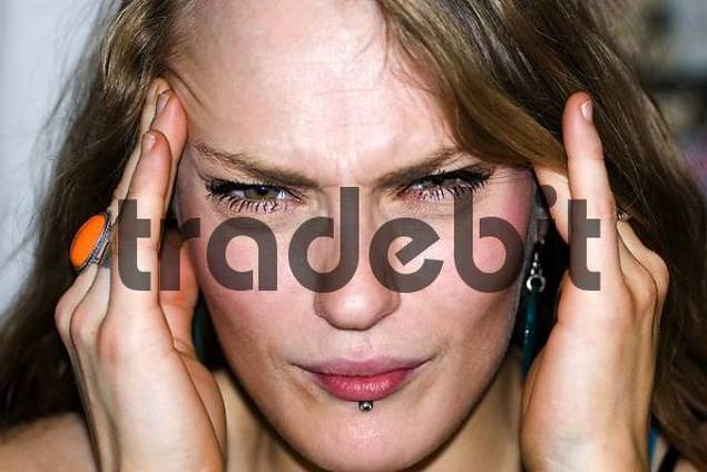 young woman with headaches