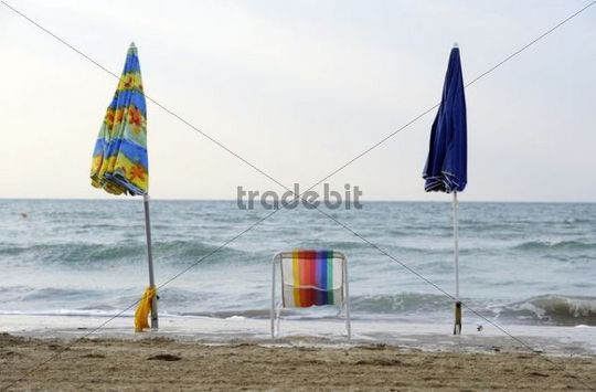 Deck chair with parasols on the beach of the northern Adriatic Sea near Cavallino camping site, Jesolo, Venice, Italy, Europe