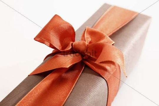 Gift with an orange ribbon