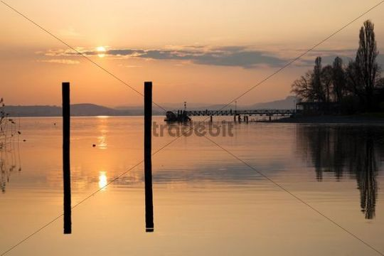 Jetty with solar-powered ferry on the Mettnau peninsula at dusk, Lake Constance, Germany, Europe, PublicGround