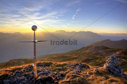 Summit cross of Mt Margelkopf above the Rhine Valley at dawn in autumn, Swiss Alps, Switzerland, Europe